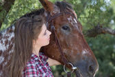 Young woman with horse — Stock Photo