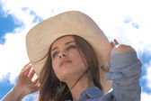 Close up portrait of happy cowgirl on roof — Stock Photo