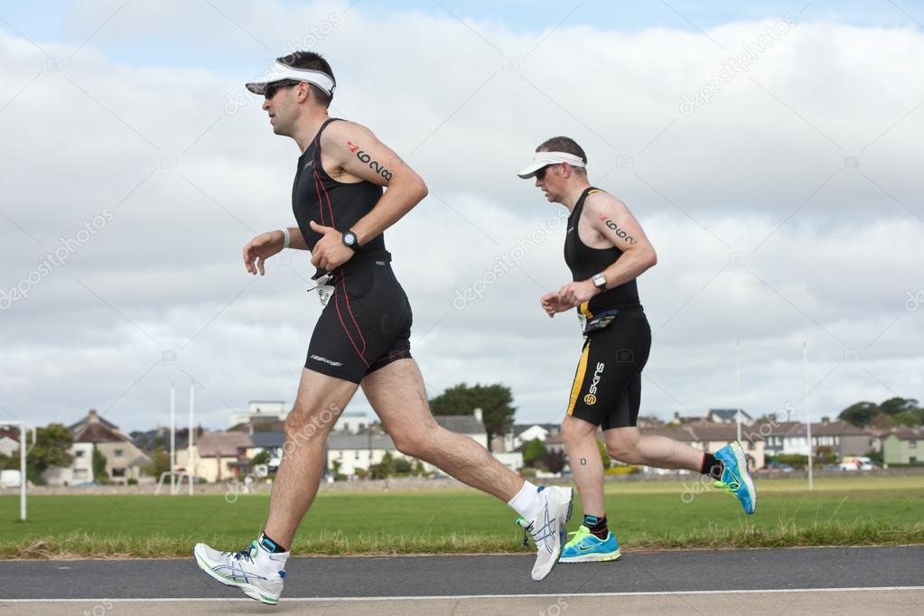 GALWAY, IRELAND - SEPTEMBER 2: Brendan Wallace (628) and other athletes competing at the Course � Run, during 2nd Edition of the Ironman 70.3 Galway 2012 Triathlon,  — Stock Photo #12899543
