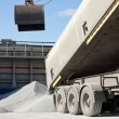 Crane loading cargo ship with gravel — Stock Photo