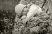 Baby boy in knitted jacket — Stock Photo