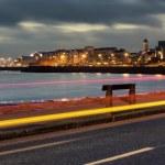 Nihgt city at the bank of ocean bay — Stock Photo #20330549