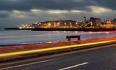Nihgt city at the bank of ocean bay — Stock Photo