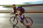 Athlet riding bicycle — Stock Photo