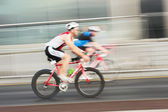 Athlets riding bicycles — Stock Photo