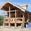 Stock Photo: Wooden house under construction