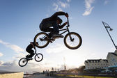 BMX stunts at the street — Stock Photo