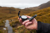 Hand with compass — Stock Photo