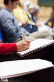 Making notes at conference, detail. — Stock Photo