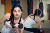 Woman working out in the gym — Stock Photo