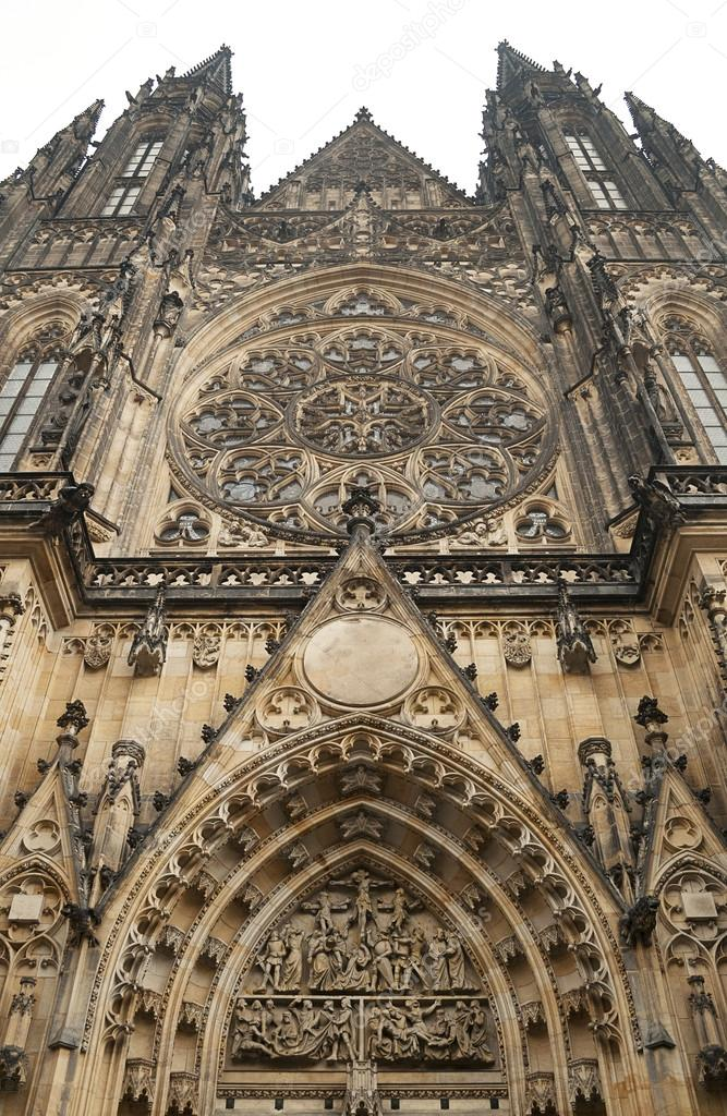 The facade of St. Vitus Cathedral in Prague with  its rose window  Stock Photo #13443079