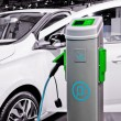 图库照片: Plug-in electric car being charged.