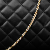 Black leather with golden chain — Stock Photo