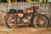 The old, rusty motorcycle — Stock Photo