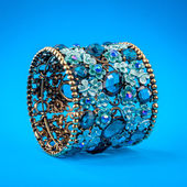 Braclet with gems on color background — ストック写真