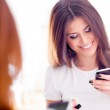 Happy woman with smart phone — Stock Photo