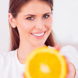 Beautiful girl with juicy orange — Stock Photo #25290895