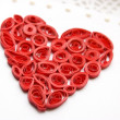 Curled red heart made from paper — Stock Photo