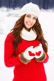 Pretty yong woman in red sweater — Stock Photo