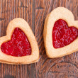 Two heart-shaped cookies with jam — Stock Photo #38580325
