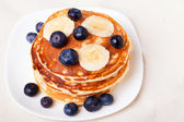 Pancakes with blueberry and bananas — Stock Photo