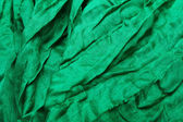 Green textile close-up — ストック写真