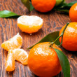 Постер, плакат: Tangerines on wooden table