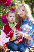 Mother and son blowing soap bubbles — Stock Photo