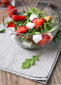 Healthy salad on the wooden table — Stock Photo