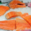 Slice fresh salmon fish on ice - Stock Photo