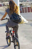 Girl on a bike — Stock Photo