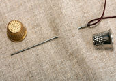 Needle and thimble — Stock Photo