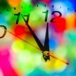 Stock Photo: Clock and Christmas background.
