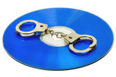 Handcuffs in DVD — Stock Photo