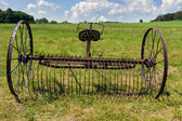 Rusty harrow plow back — Stock Photo