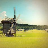 Old windmill retro style — Stock Photo