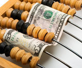 Dollar banknote in wooden abacus — Stock Photo