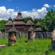 Old beehives and old church wooden — Foto de Stock