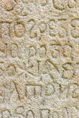 Old alphabet on stone — Stock Photo