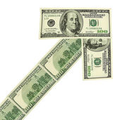 Arrow made of dollars — Stock Photo