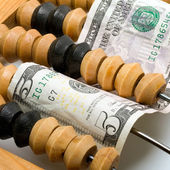 Abacus and dollar banknote concept — Stock Photo