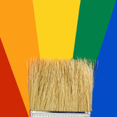 Multicolored paints and brush — Stock Photo