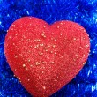 Heart on background tinsel — Stock Photo #33994123