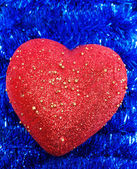 Heart on background tinsel — Stock Photo