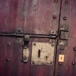 Lock in old wooden door — Stock Photo