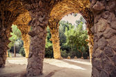 Ancient aqueduct in the park Guell — Stock Photo