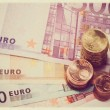 Euro coins on euro banknotes — Stock Photo #36223947