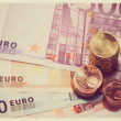 Stock Photo: Euro coins on euro banknotes