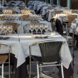 Stock Photo: Restaurant tables set for meal