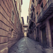 Aged street in Barcelona. Catalonia, Spain. — Stockfoto